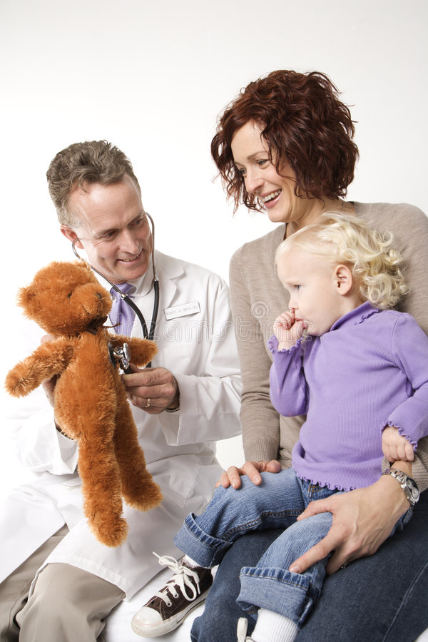 Doctor using teddy for comfort royalty free stock photos