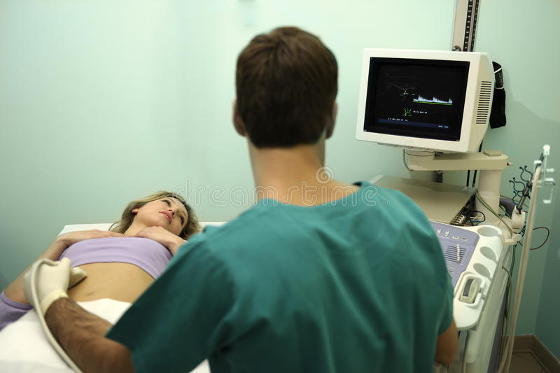 Doctor using ultrasound machine royalty free stock images