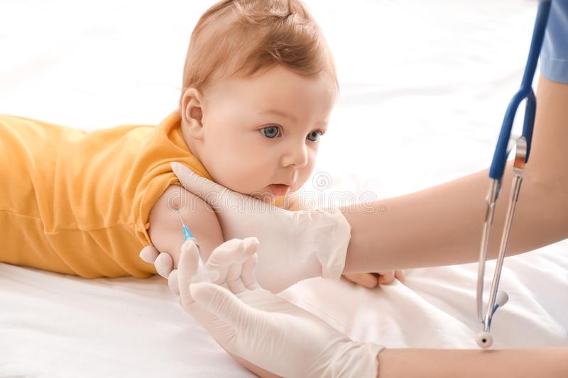 Doctor vaccinating little baby royalty free stock photos