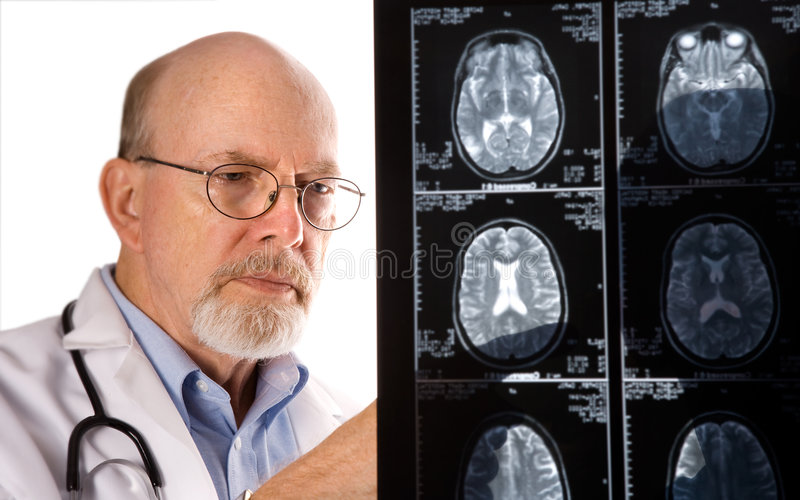 Doctor Viewing MRI Films. Doctor evaluating patient's MRI scans stock images