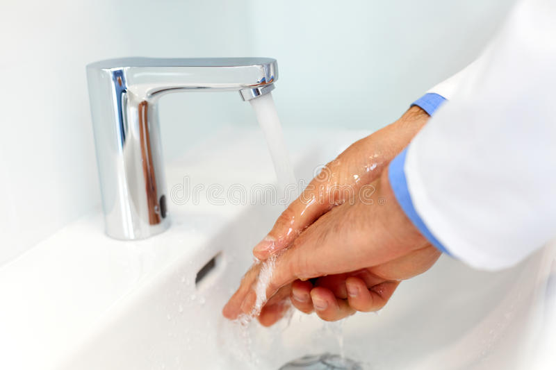 Doctor Washes Hands Before Medical Work. Dental Clinic stock photo