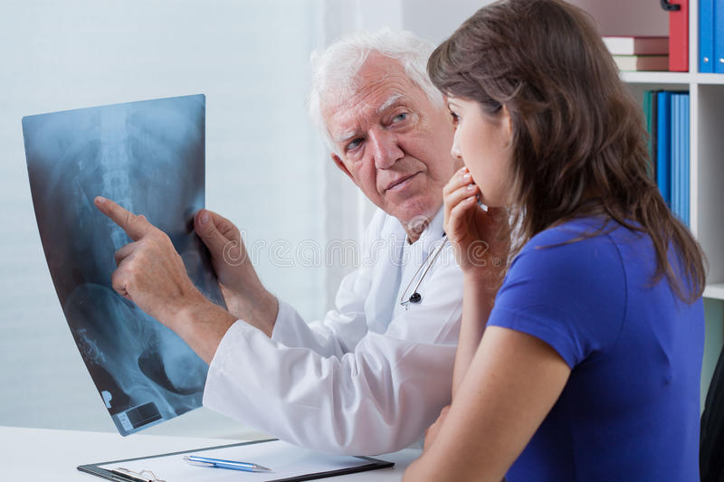 Doctor watching x-ray photo. With his patient stock photos
