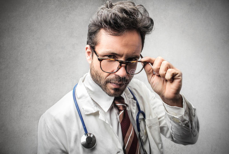 Doctor wearing glasses stock photography