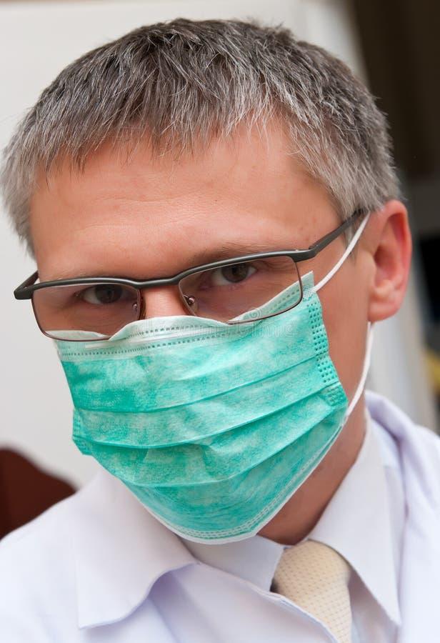 Doctor wearing mask stock photos