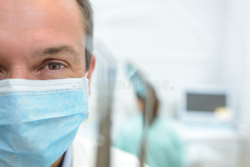 Doctor wearing a mask royalty free stock photo