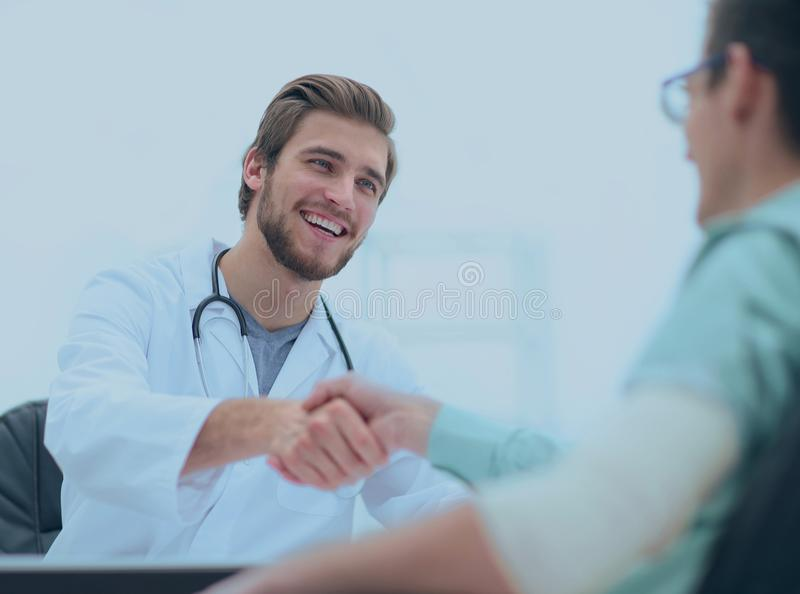 Doctor welcoming a patient in his studio stock photography