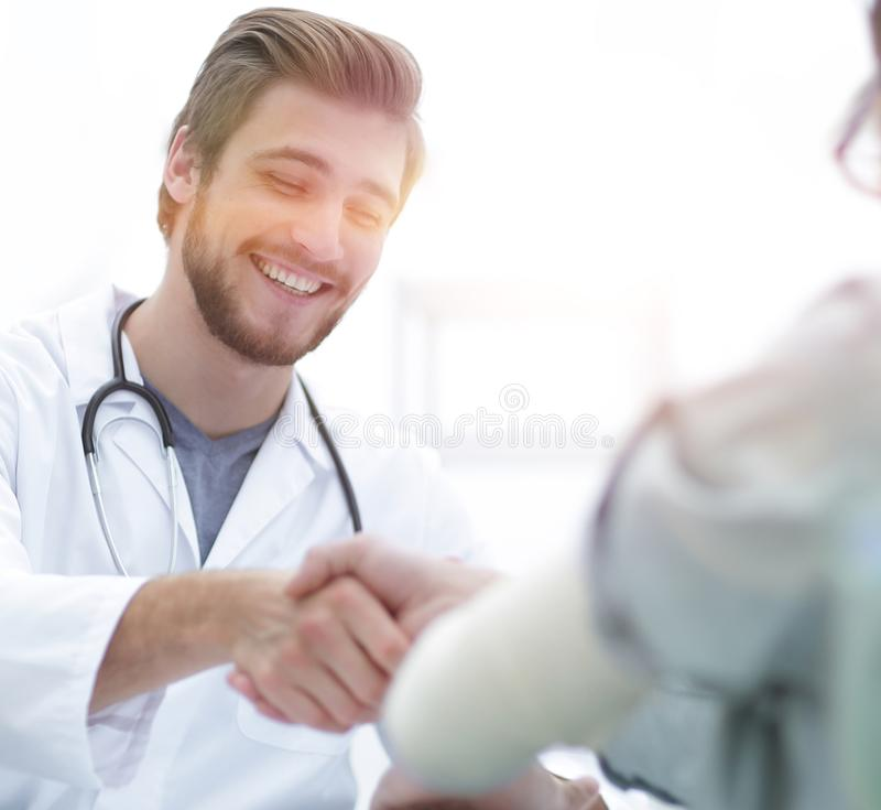 Doctor welcoming a patient in his studio royalty free stock images