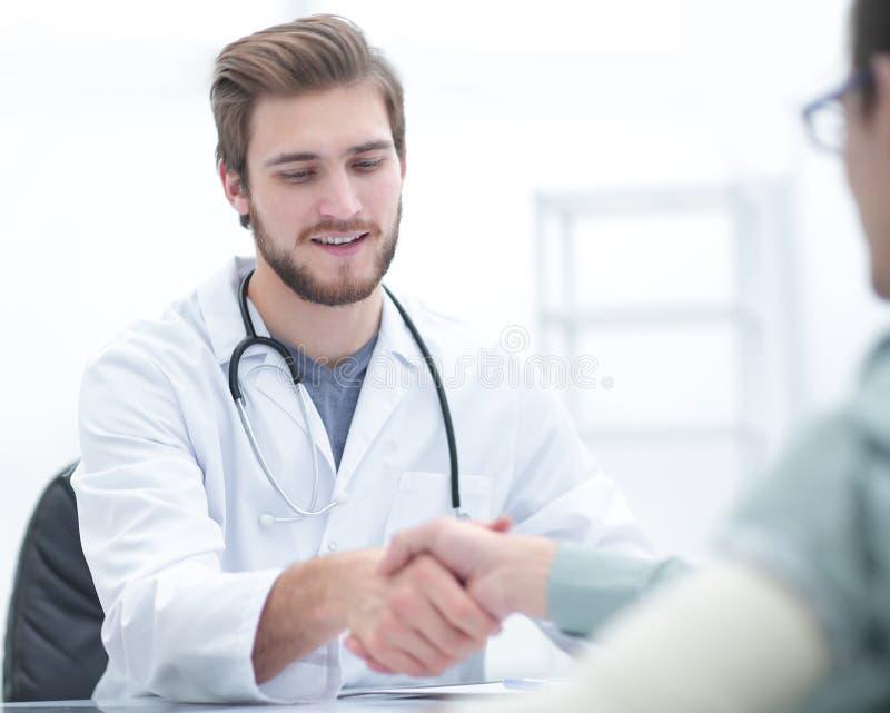 Doctor welcoming a patient in his studio stock photos