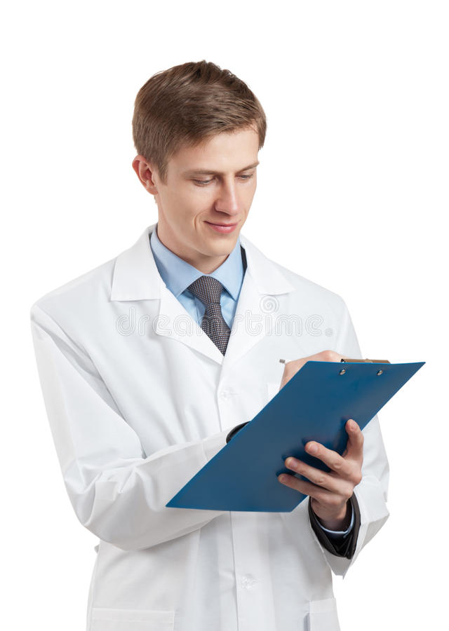 Doctor in a white coat and with a clipboard royalty free stock photography