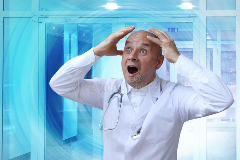 Doctor in a white coat with a phonendoscope around his neck, in despair stretches his arms, screaming, opening his mouth stock photos