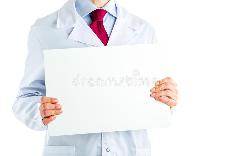 Doctor in white coat showing a white blank signboard royalty free stock photo