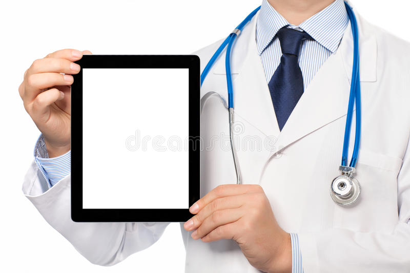 The doctor in a white coat with a stethoscope holding tablet wit. The doctor in a white coat with a stethoscope holding tablet computer with isolated screen royalty free stock image