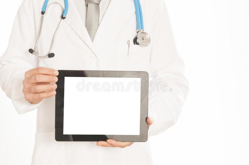 Doctor in white coat with stethoscope showing blank digital tablet pc Isolated on white stock images