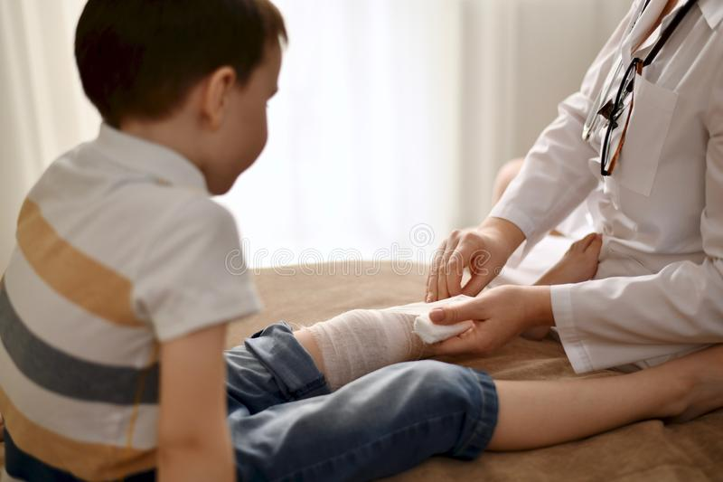 The doctor provides first aid at home. stock photos