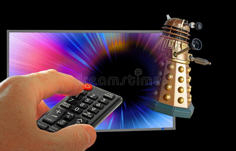 Doctor who tardis chase dalek through space television show remote control hand royalty free stock photography