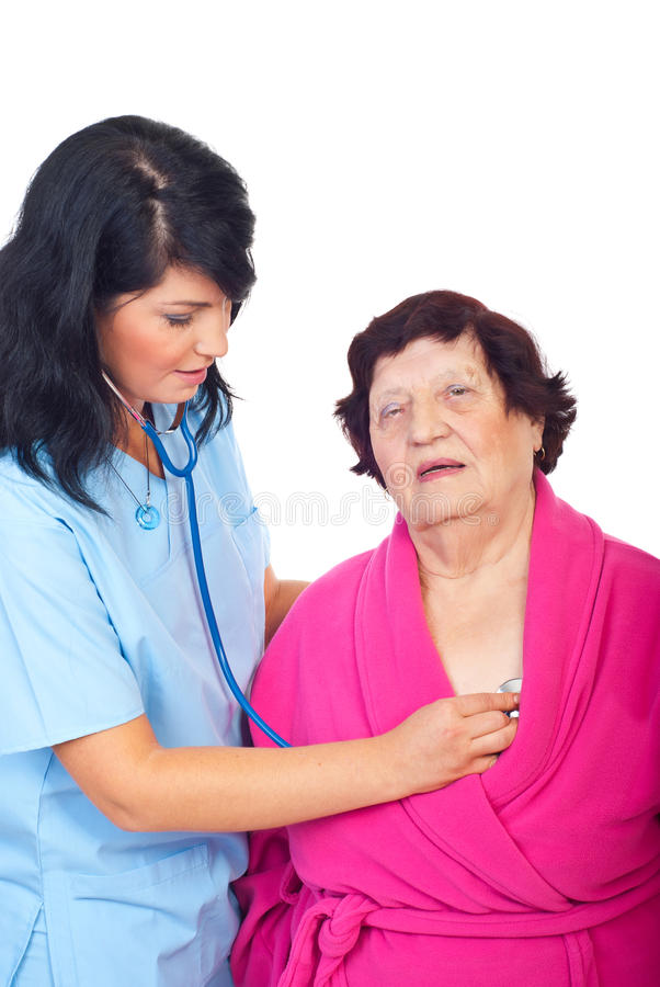 Doctor woman assessing elderly patient royalty free stock images