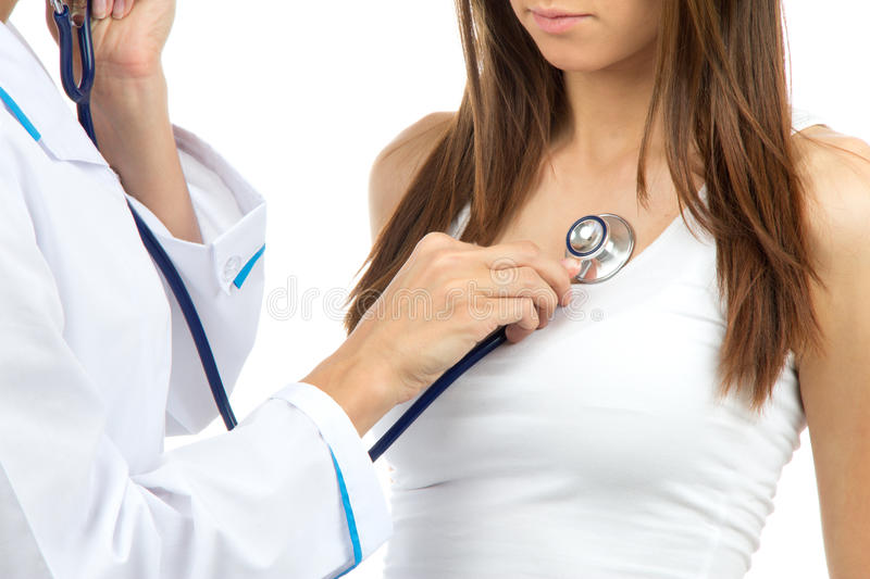 Doctor woman auscultating young patient royalty free stock photography