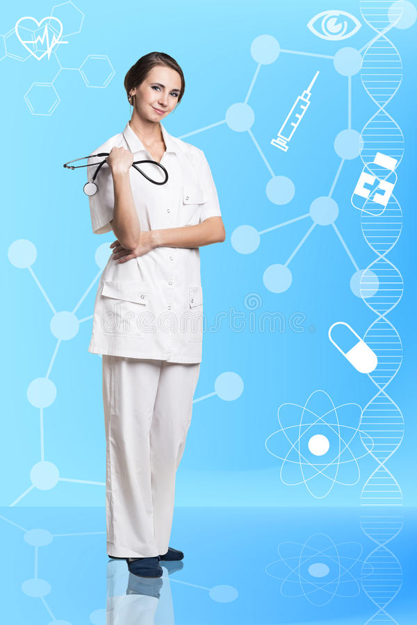 Doctor woman. Crossed her arms over her chest, one hand holding a stethoscope royalty free stock photo
