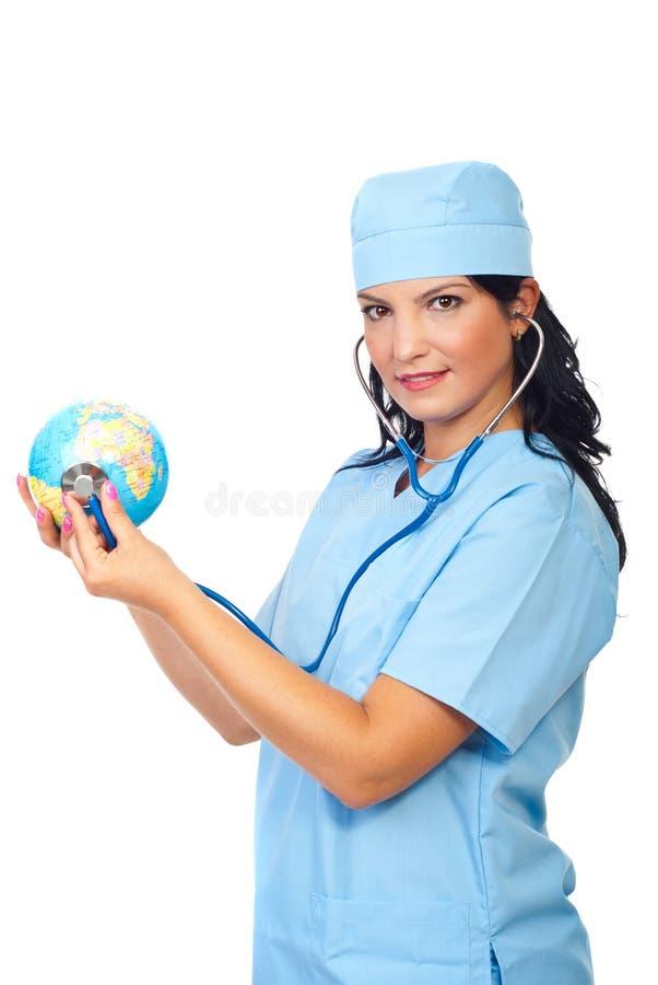 Doctor Woman Examine Globe Stock Photo
