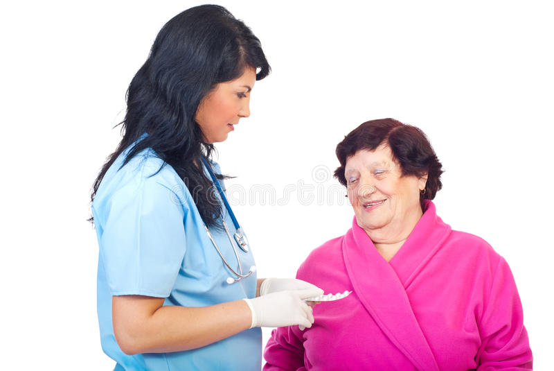 Doctor Woman Give Pills To Elderly Woman Royalty Free Stock Photography
