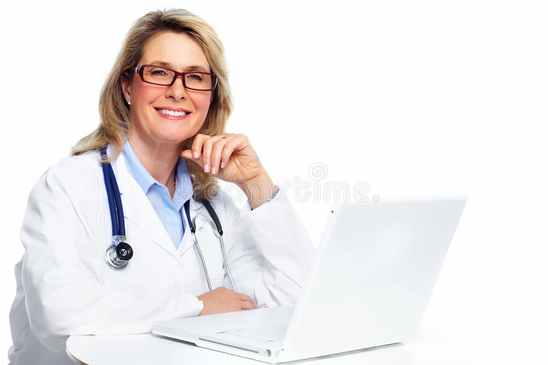 Doctor woman with laptop computer. Smiling medical doctor woman with stethoscope. Isolated on white stock photo