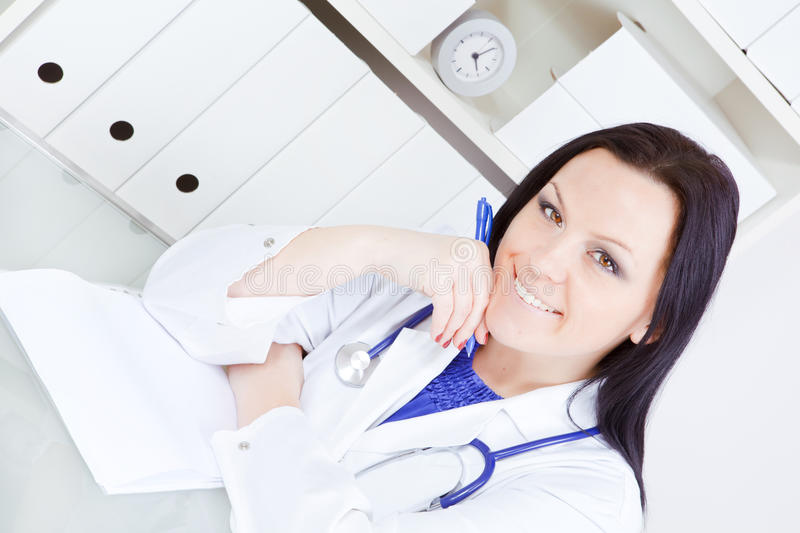 Download Doctor Woman Making Notes In Surgery Office Stock Image - Image: 18138053