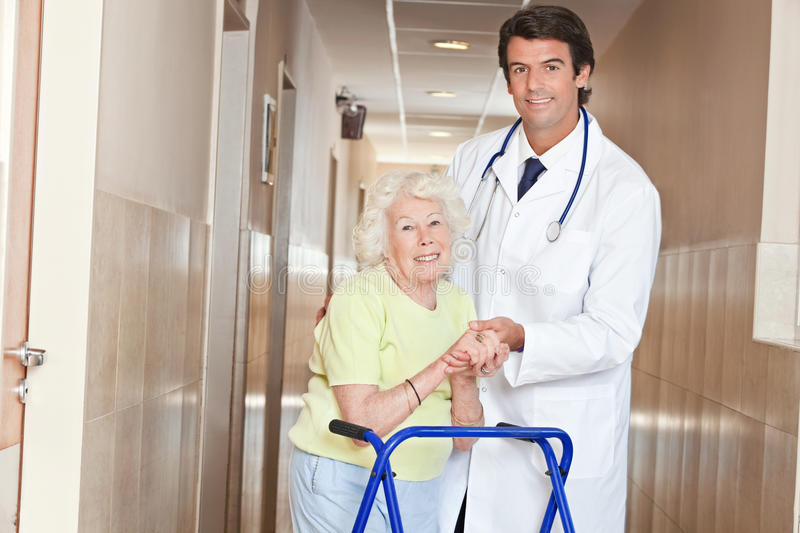 Doctor and Woman with Zimmerframe stock photos