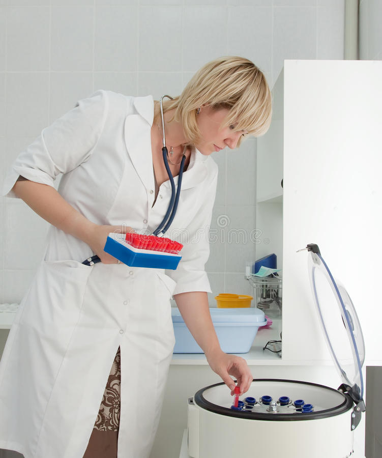 Doctor working with blood centrifuge royalty free stock image