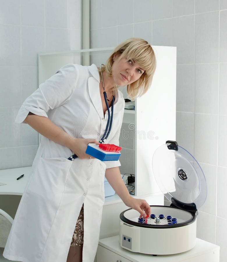 Doctor working with blood centrifuge stock images