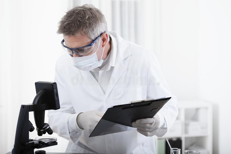 Doctor working with clipboard and blood royalty free stock photos