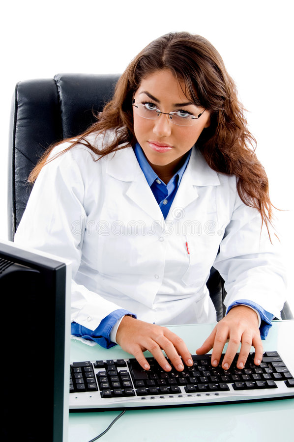 Doctor working on computer royalty free stock photography