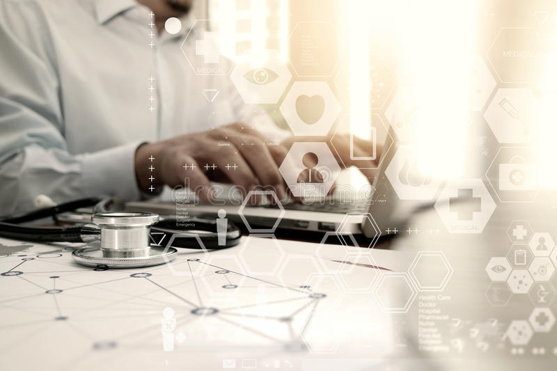 Doctor working with laptop computer in medical workspace office. And medical digital network media diagram as concept stock image