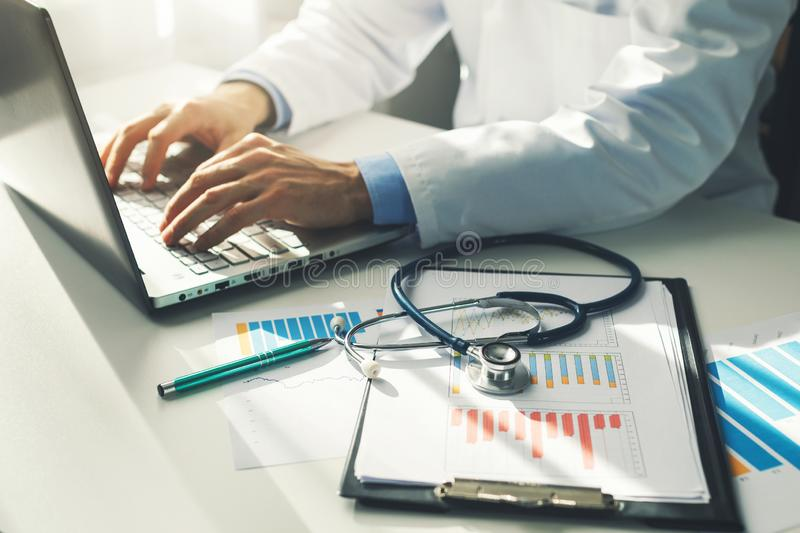 doctor working with medical statistics and financial reports royalty free stock image