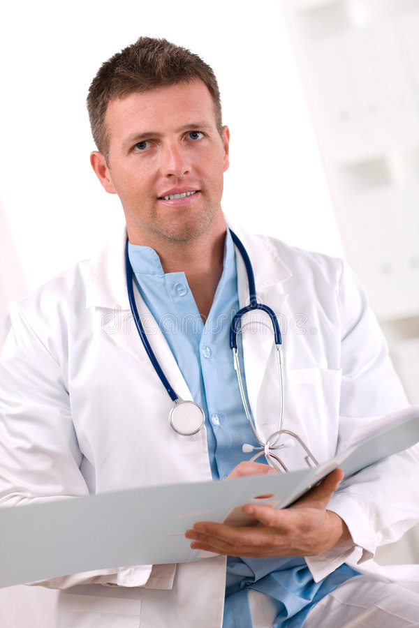 Doctor working at office stock image