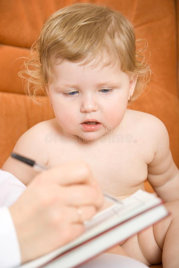 Doctor write receipt for little patient stock images