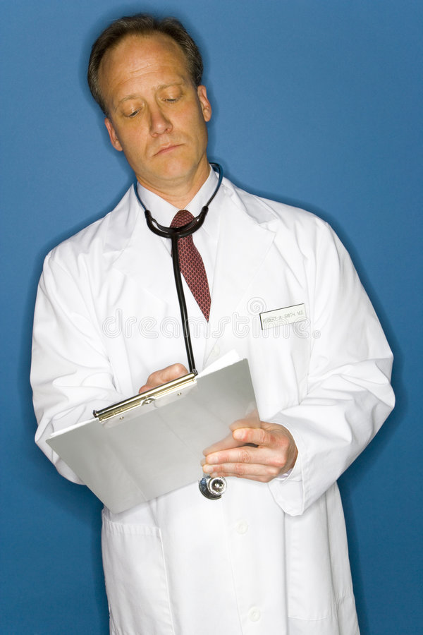 Download Doctor Writing On Clipboard Stock Photo - Image: 5646128