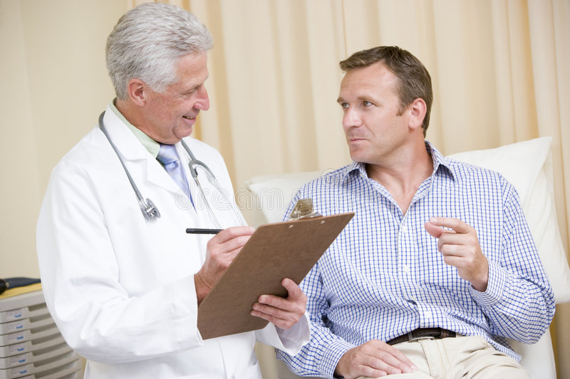 Doctor writing on clipboard stock photos