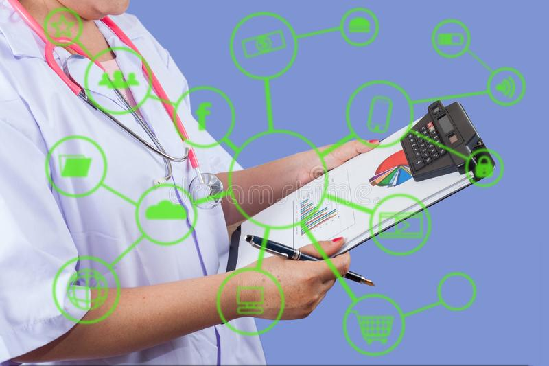 Doctor writing on clipboard for patient chart. Healthy and technologies concept royalty free stock images