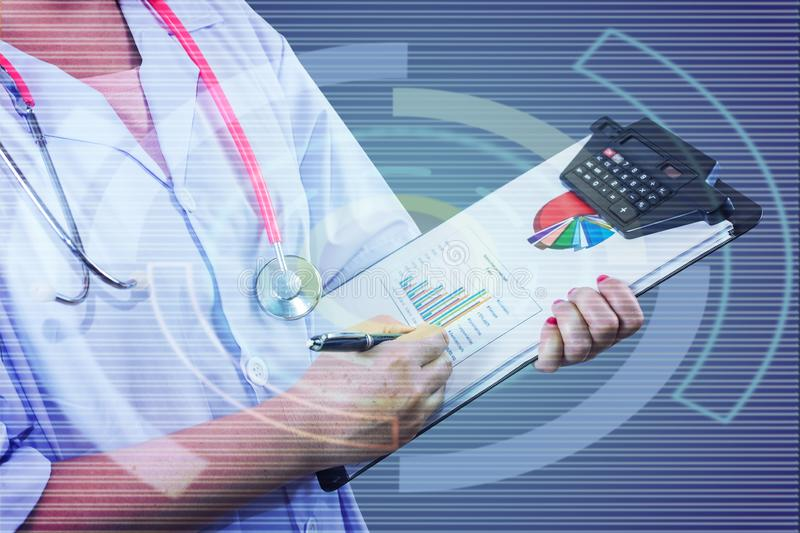 Doctor writing on clipboard for patient chart ,Healthy and technologies concept. Doctor writing on clipboard for patient chart ,Healthy and technologies royalty free stock photo