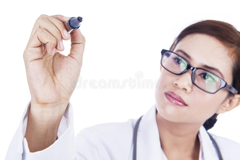 Doctor writing on copyspace isolated in white