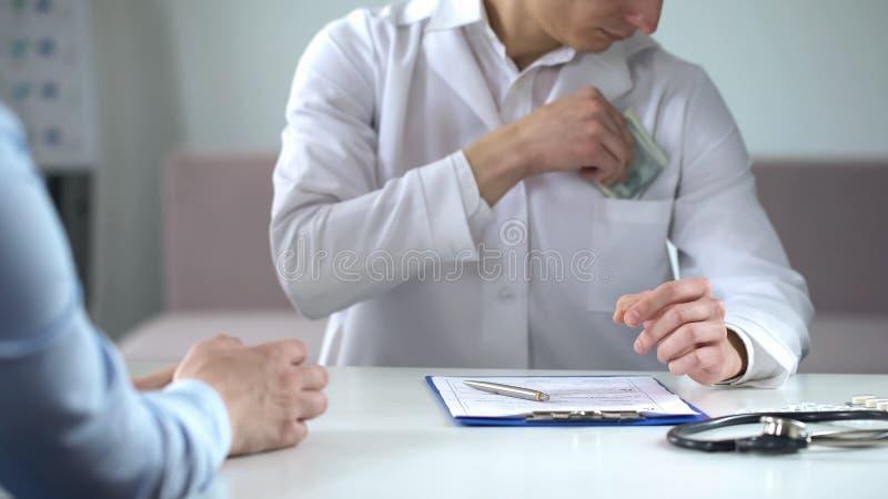 Doctor writing fake medical examination, taking bribe, expensive checkups royalty free stock images
