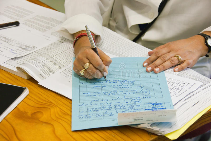 Doctor writing file royalty free stock image