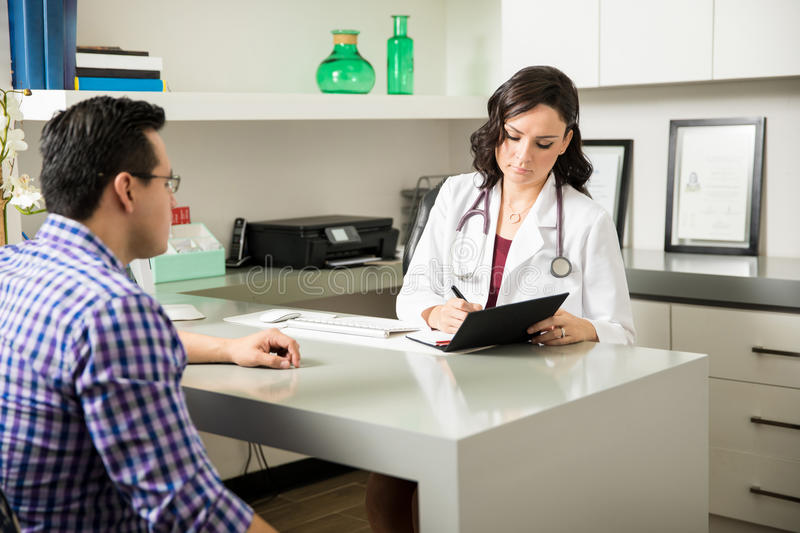 Doctor writing a medical prescription royalty free stock images