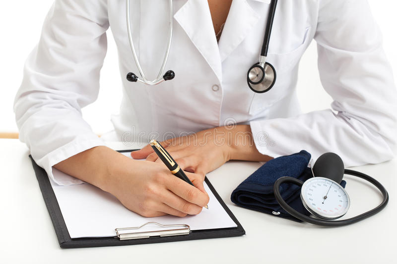Doctor writing out a prescription royalty free stock photography