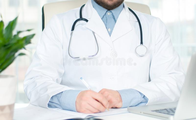Healthcare and medical concept. Doctor writing prescription stock photo