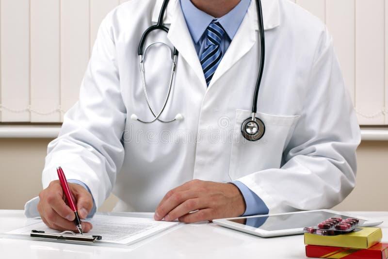 Doctor Writing A Prescription Or Medical Notes Stock Photo