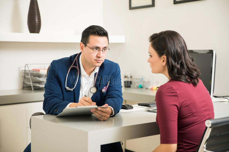 Download Doctor Writing A Prescription For Patient Stock Photo - Image: 83707384