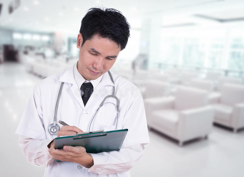Doctor writting medical report stock photos