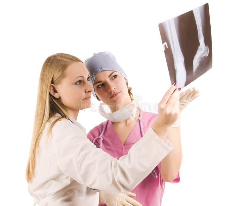 Doctor y enfermera en trabajo imagenes de archivo