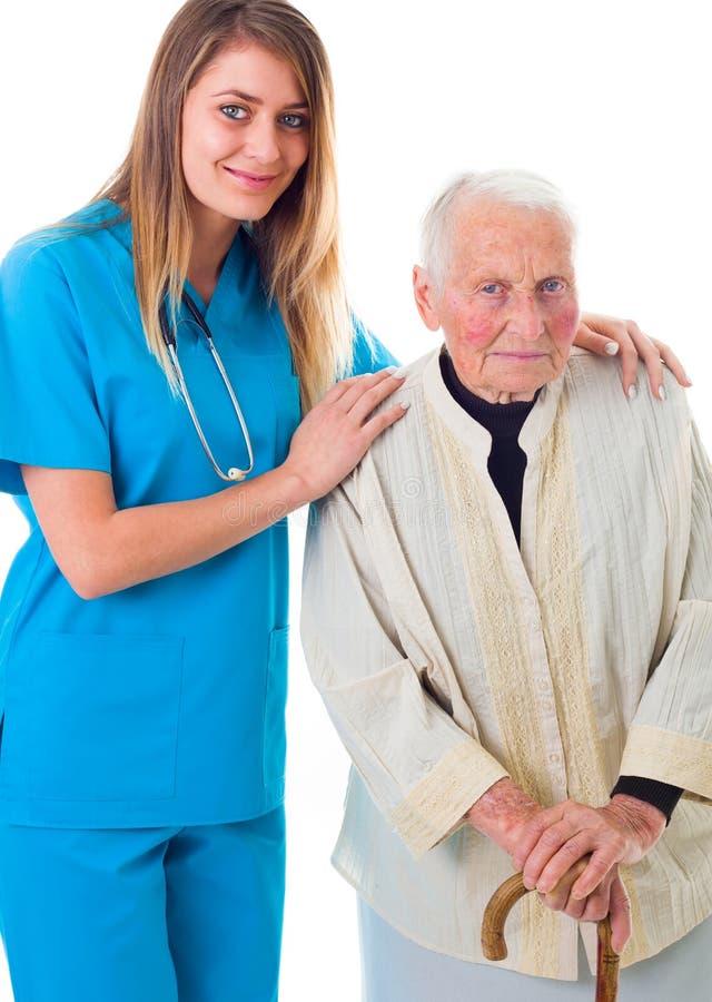 Doctor y paciente mayor junto fotografía de archivo libre de regalías